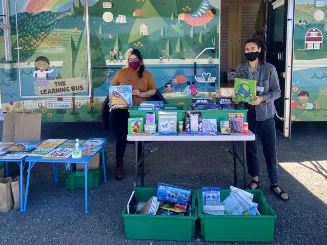 Alejandra & Maribel distributing free books and materials at Mesa Park in Bolinas.